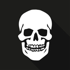Human skull on a black background with long shadow