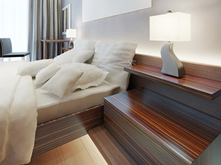 Modern wooden bedside nightstand in the form of shelves.