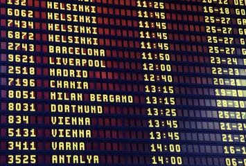 Flights information board in airport terminal