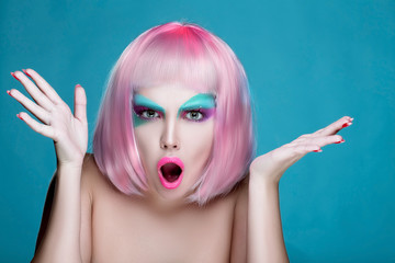 Dissatisfied Portrait of Girl with Hands with makeup and pink wig. Ideal promotion photo.
