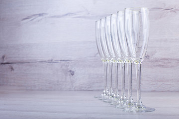 photo of  champagnes glasses on wooden background
