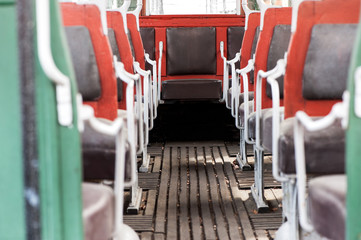 colorful interior seating on a vintage bus