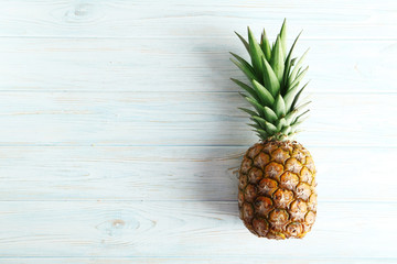 Ripe pineapple on a blue wooden table Wall mural