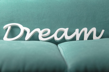 Dream white letters on a blue green soft textile background