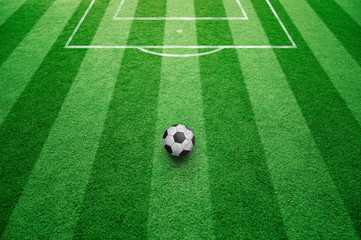 Conceptual soccer free kick ball background. Football ball on sunny soccer field ground.