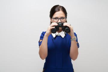 Girl in a blue suit. Keep a binoculars in her hands. Makes gestu