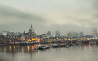 Looking eastwards over the Thames past St Paul's Cathedral and a foggy City of London