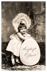 Vintage easter card. Funny sweet little girl and big egg