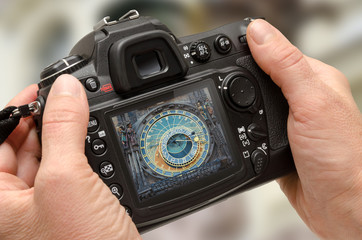 Photo of Prague astronomical clock on camera display during the city break travel. Travel photography.