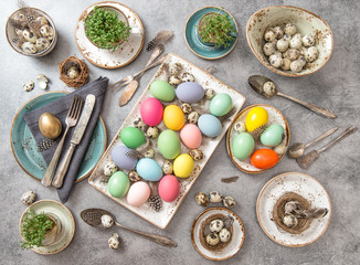 Easter decoration. Festive table setting colored eggs