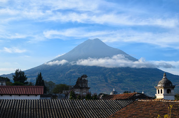 Volcano Agua above rooftops of old Antigua quarters