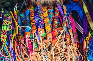 Numerous wristbands with Guatemala sing at the craft market