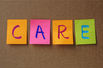 care text on colorful sticky notes
