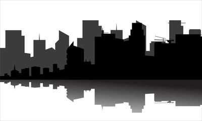 silhouette of the city beside the river