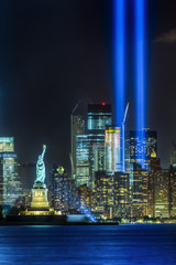 Printed roller blinds Historical buildings NEW YORK CITY - SEPTEMBER 11: The Statue of Liberty as seen in the evening of September 11, 2015 in New York City. The 9-11 memorial lights can be seen in the background.