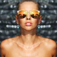 Fashion closeup portrait of young seductive woman in sunglasses