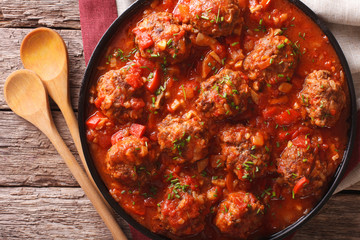 Albondigas meatballs with sauce on a plate close-up. horizontal top view