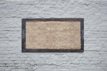 Wooden board on white bricks wall