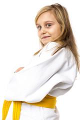 Portrait of an adorable  karate girl in kimono