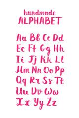 Handwritten calligraphic white alphabet written with brush pen on black background. Handmade ABC font typography