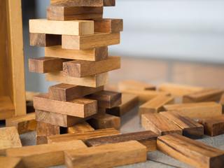 Closeup of asian kid's hand playing wood blocks stack game (jeng