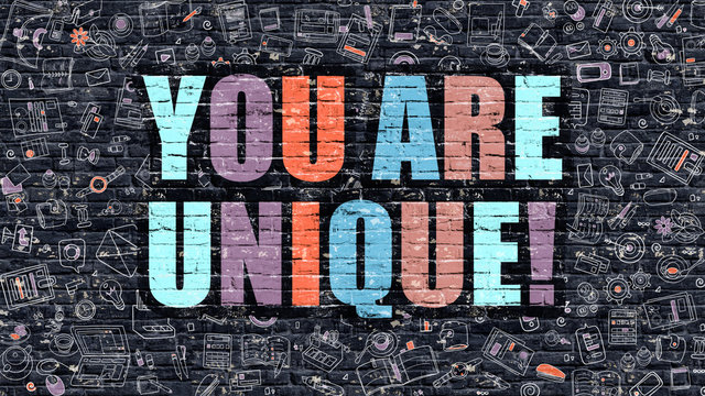 You are Unique. Multicolor Inscription on Dark Brick Wall with Doodle Icons. You are Unique Concept in Modern Style. Doodle Design Icons. You are Unique on Dark Brickwall Background.