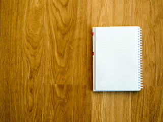 Empty notebook on wooden vintage table with copy space