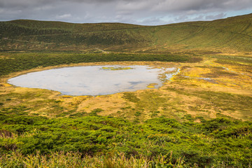 Azores landscape with lake in Flores island. Caldeira Rasa. Port