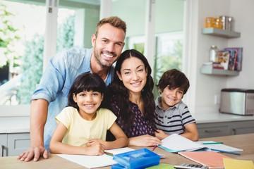 Parents assisting children doing homework