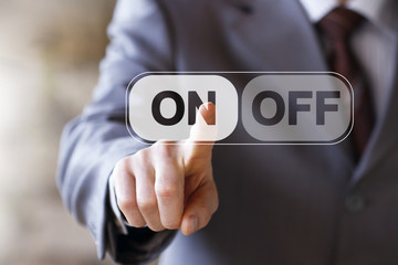 Businessman pressing ON OFF web button