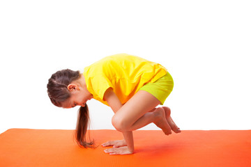 kid practicing yoga isolated