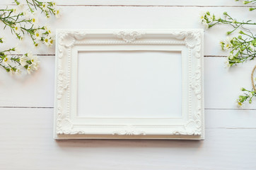 Vintage frame on white wooden background