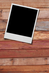 White paper picture frame on wood background texture