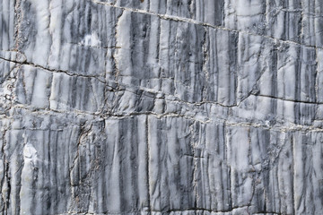 Closeup abstract background texture photo of marble stone slab with natural streak limestone pattern