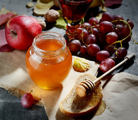 bread with honey, grapes, nuts and apples