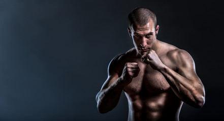 muscular powerful man in full guard ready for fight with copy space