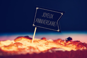 cake with text joyeux anniversaire, happy birthday in french