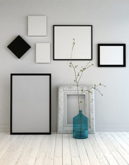 Assortment of different frames on a grey wall