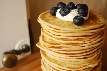 pancakes with soured cream and blueberries