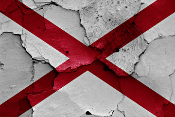 flag of Alabama painted on cracked wall
