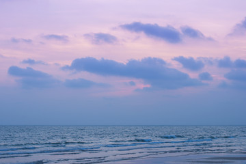 Wall Mural - Sunset above sea beach with rose quartz and serenity tone