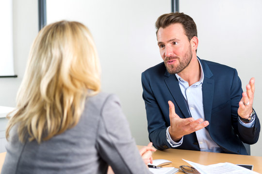 Young attractive employer doing a job interview to a woman