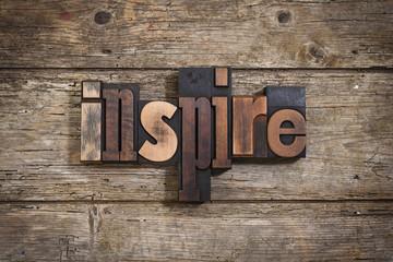 inspire written with letterpress type
