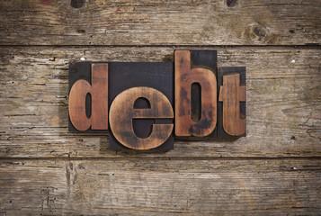 debt written with letterpress type