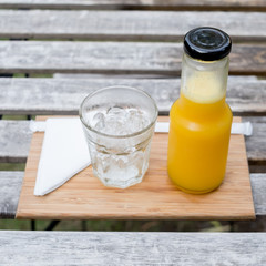 Juice bottle on wood background - Fresh orange juice on wooden