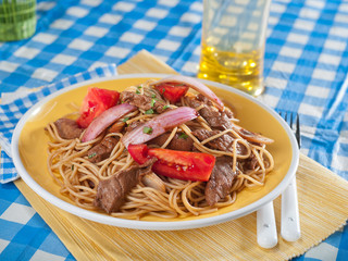 Beef, onion, and noodle stir fry, Lomo Saltado, a typical Peruvian dish