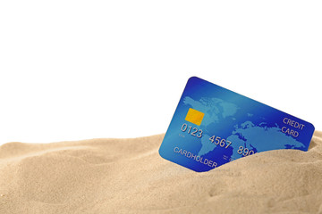 Blue bank card in sand isolated on white