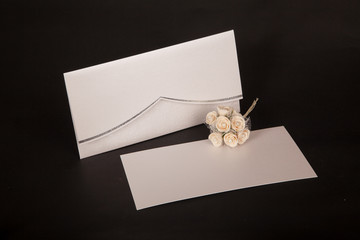 Envelope and mail wedding invitations on black blackground