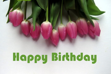 Happy Birthday in green text with bunch of pink tulips