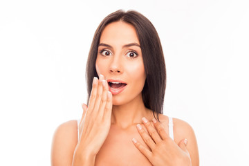 Portrait of shocked attractive girl holding hand near mouth